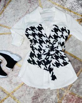 Camisa / vestido estrella , color blanco y negro , con cierre de botones y cinturón a juego incluido. Tallas 4 a 14 años (Tallas pares). Puedes combinarla con nuestra deportiva arcoíris disponible en la sección de calzado.